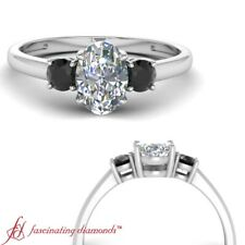 Oval Shaped And Black Diamond Three Stone Engagement Ring In Platinum 0.90 Carat