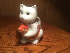Teapot-- cat with fish