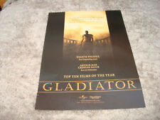 Gladiator 2000 Oscar ad Russell Crowe as Maximus with sword in Colosseum