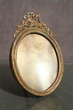 Cadre à vue ovale en bronze 19e style Louis 16