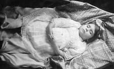 Old Photo.  Postmortem - girl on blanket - bow in her hair