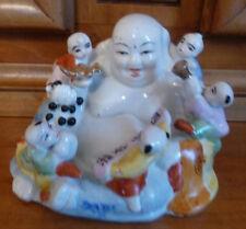 bouddha porcelaine avec des enfants colombe et trompette dorés très bon état gén
