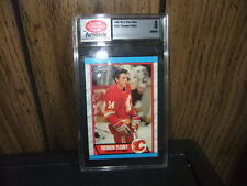 1989-90 Theoren Fleury O-Pee-Chee rookie card graded 8 Sports Collecters Digest