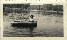 Vintage old photo-snapshot-pneumatic boat river woman-boat river