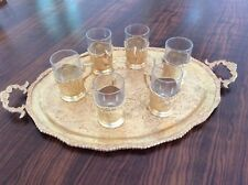MIDDLE EASTERN SET OF SIX VINTAGE GLASS HOLDERS, GLASSES AND TRAY IN GILT METAL