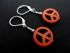 A PAIR OF ORANGE HOWLITE SILVER PLATED PEACE SIGN LEVERBACK HOOK  EARRINGS. NEW.