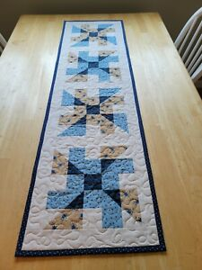 Handmade quilted table runner pinwheel design blues and brown