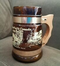 "Vintage Stein from Niagara Falls Brown Glass, Wood Handle 5 1/4"" Tall, 3"" Base"