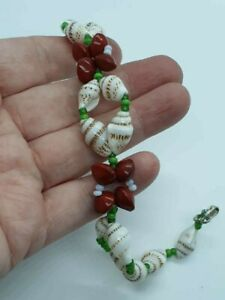 Fashion jewellery Bracelet mix of plum/white / green  beads with some shells