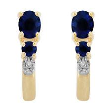 Orecchini di lusso con gemme blu tonda in oro giallo