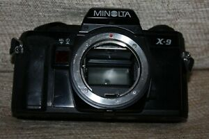 Three Minolta Camera Bodys