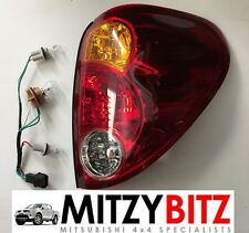 MITSUBISHI L200 WARRIOR ANIMAL TROJAN B40 2.5 Di D 06> OSR REAR LIGHT LENS NEW