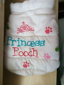 "WHITE PUFFA  DOG COAT/JACKET, WITH "" PRINCESS POOCH "" ON."
