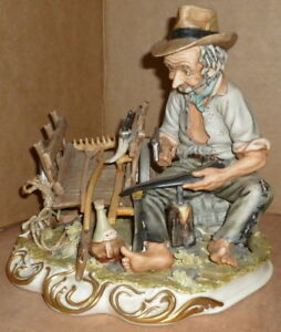 Capodimonte Figurine Peasant Repairing His Scythe