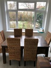 Mango wood dining table with six rattan chairs brown