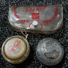 gold and silver coca cola yoyo
