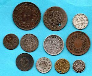 11 TURKEY COINS AH 1223 - 1327, C AD 1808 - 1909. INCLUDING SILVER. JOB LOT.