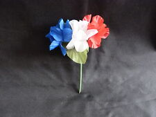 RED WHITE AND BLUE FLOWER CORSARGE