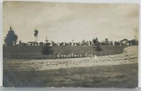Canby MN Cemetery, Mill / Elevator in Distance RPPC Real Photo 1909 Postcard K11