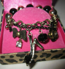BETSEY JOHNSON BLACK HIGH HEEL WITH BOW AND FLOWER AND BLING STRETCH BRACELET