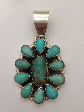 Sterling Silver Genuine Turquoise Oval Teardrop Flower Pendant by Silver Ray