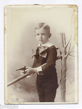 1880's CABINET PHOTO: LAWRANCE ELLIOT HOLDING ORNATE TERROR IRON TOY CAP PISTOL