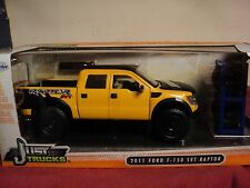 Jada 2011 Ford F-150 SVT Raptor pickup truck  NIB w/extra wheels  yellow  1/24