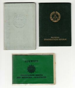 East Germany German DDR lot of documents 1 person , police helper , red cross