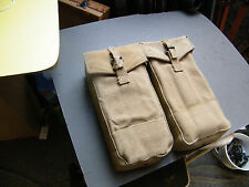 Pair of Brit. army unworn canvas front  pouches black metal buckles. 5x10x3 ins.