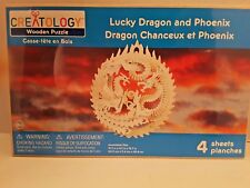 """Nip.Lucky Dragon and Phoenix Wooden Puzzle, 15"""" Hanging Mobile by Creatology"""
