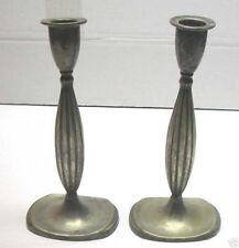 A PAIR OF SOLID SILVER CANDLESTICKS