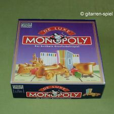 Deluxe Monopoly DM 9 Spieler goldfarbene Metallfiguren m. Lok Holzhäuser 1A Top!
