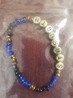 handmade unique womens glass bead blue/black strength stretch bracelet