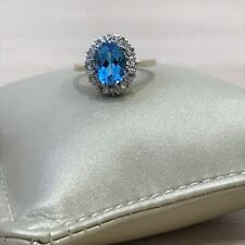 Genuine 14k gold and diamond oval 9X7mmblue topaz retro halo engagement ring