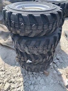 set of 4 10-16.5 tires and rims 10 Ply Manitou Gehl Wacker Neuson Loader