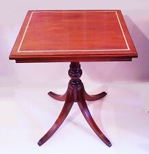 Vintage side table. Federal style fluted leg . Gold trim on top. Dark cherry.