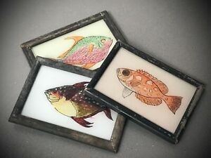 VINTAGE INDIAN REVERSE GLASS PAINTINGS: EXOTIC TROPICAL FISH. SET OF THREE.