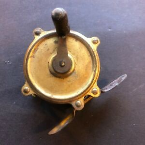 Antique brass fishing reel, c1910
