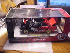 M2 Machines 1/24th Scale 1 0f 8380 1970 Datsun 710 Black & Red