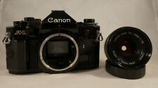 Canon A-1 35mm SLR Film Camera with Canon FD 50mm f/1.8 Prime Lens Manuals
