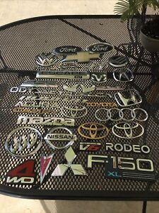Lot of 34 Authentic Dodge, Pontiac, Chrysler, Toyota, Volkswagen Emblems OEM.