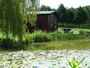 secluded romantic log cabin  carp fishing  lake,  short break holiday glamping