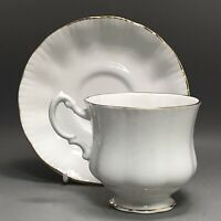 Vintage pretty plain white tea cup & saucer with gold gilt trim - bone china