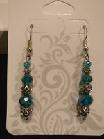 Intricate dangle blue glass bead earrings with dainty silver accents. Handmade!