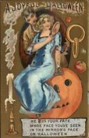 Halloween - Beautiful Woman w/ Mirror Sitting on JOL c1910 Postcard
