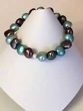 Peacock & Teal stretchy pearl bracelet with sterling silver stardust spacer