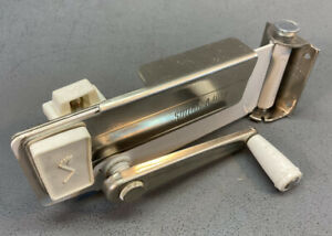 Vintage Swing-A-Way Wall Mount Can Opener with White Handle Accents Preowned