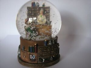 christmas snow globe with Old Lady doing her shopping