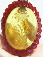 LAMINATED 2 TONE FLORAL CARVED CHERRY RED & APPLE JUICE BAKELITE OVAL DRESS CLIP