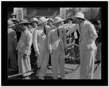 Jean Harlow Scene from a Film Three Men standing on a Public Market in White Hat